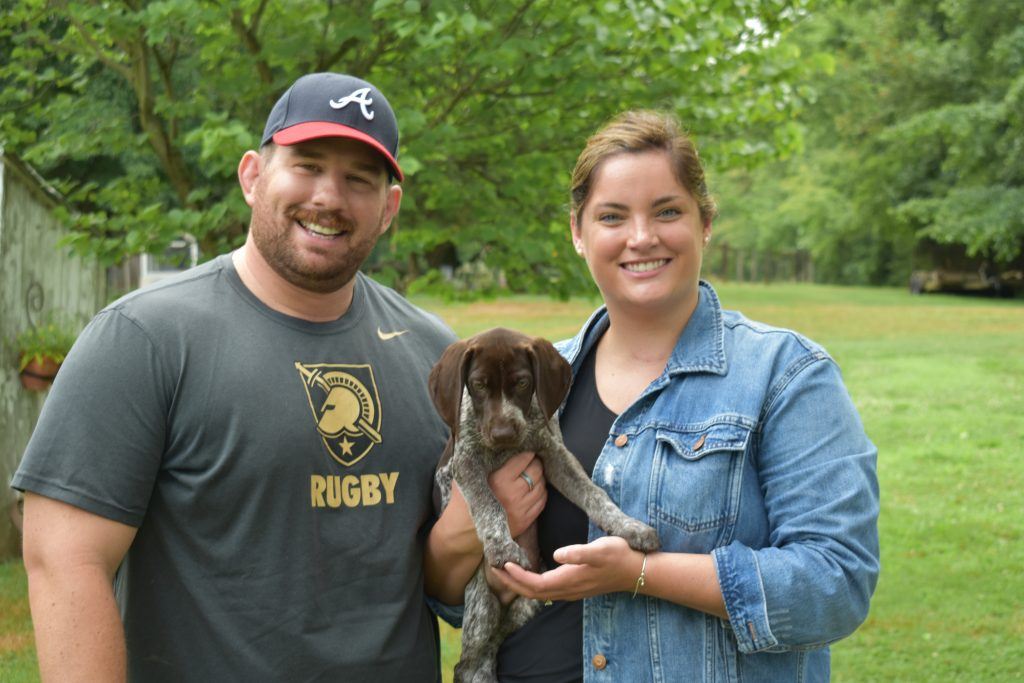 Family's with their German Shorthaired Pointers